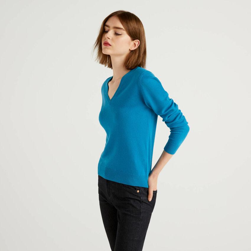 Pull bleu canard avec col en V en pure laine vierge