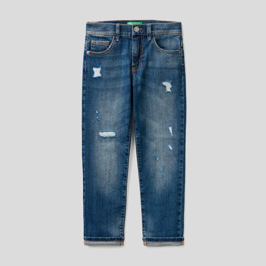 Jeans en coton stretch avec déchirures