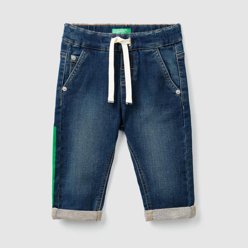 Jeans stretch avec cordon de serrage