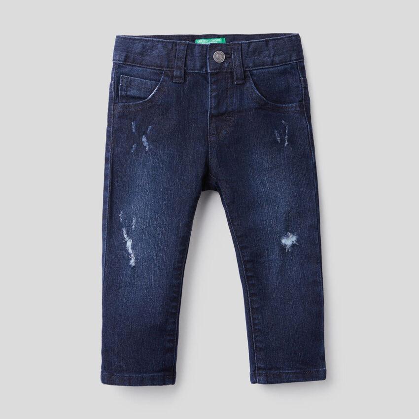 Jeans effet usé en coton stretch